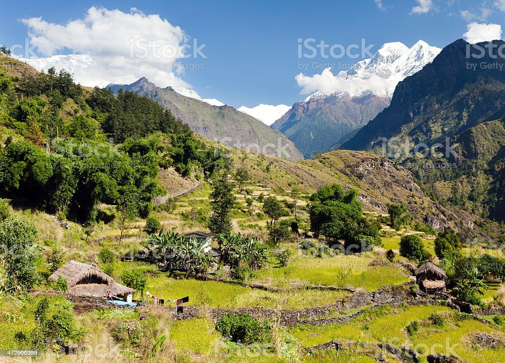 Beautiful village in western Nepal with mount Dhaulagiri stock photo