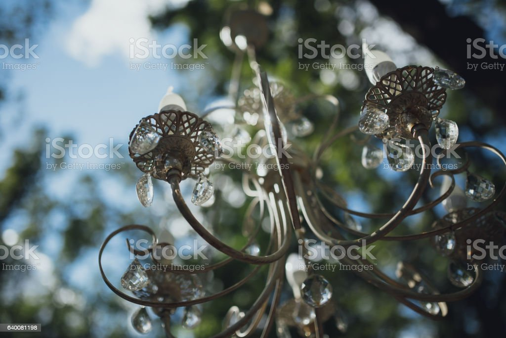 Beautiful Vintage chandelier hanging on the street stock photo