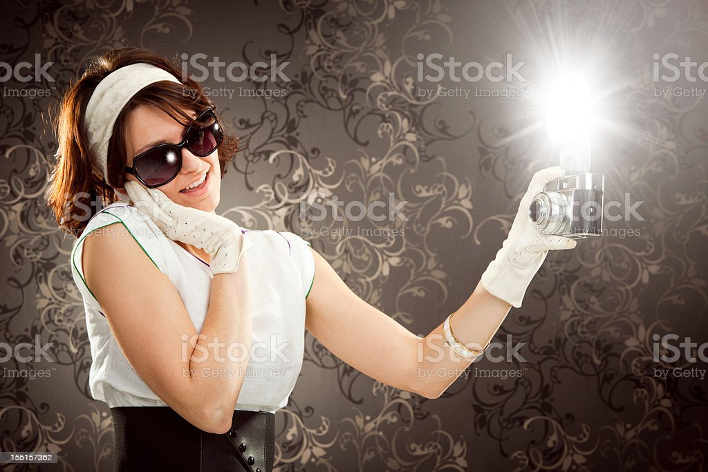 beautiful vintage diva girl shoot photograph with camera and fla stock photo