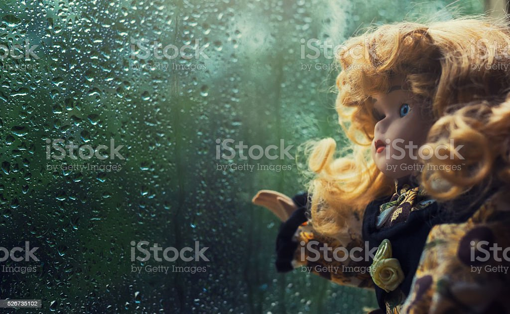 Beautiful vintage doll with golden hair stock photo