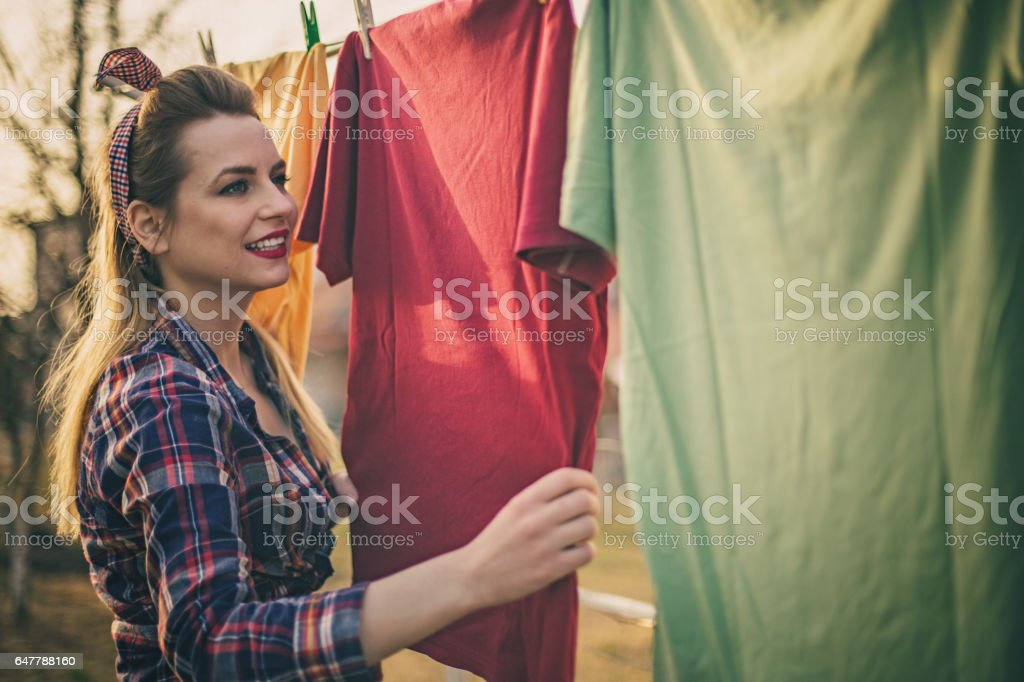 Beautiful vintage girl doing laundry stock photo