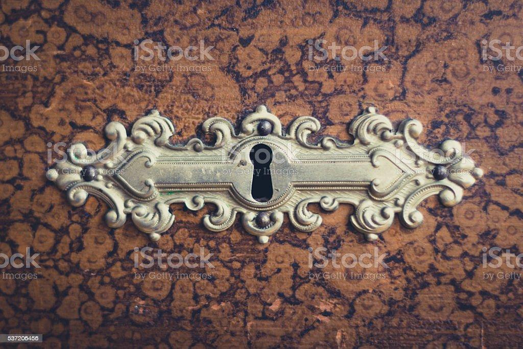 beautiful vintage keyhole on wooden furniture stock photo