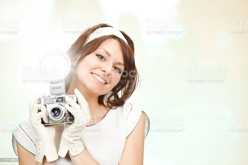 beautiful vintage style girl shoot photograph with camera and fl royalty-free stock photo