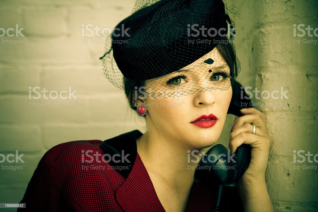 Beautiful vintage woman on the telephone stock photo