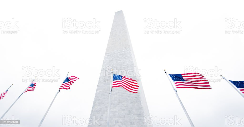 Beautiful Washington Monument with American flags stock photo
