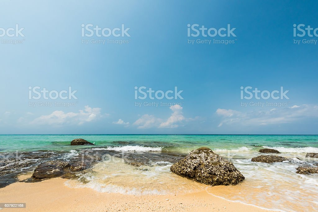 Beautiful water splash and breaking at the exotic beach stock photo
