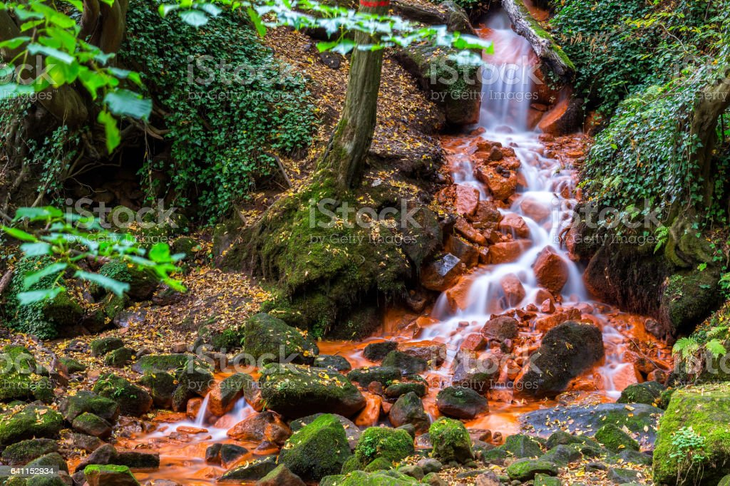 Beautiful waterfall in deep forest stock photo