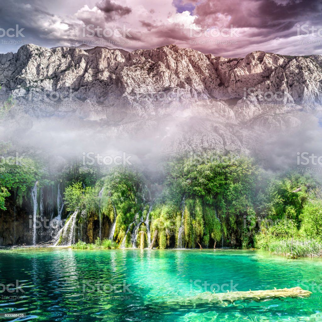 Beautiful waterfall in the jungle with rocks in the background stock photo