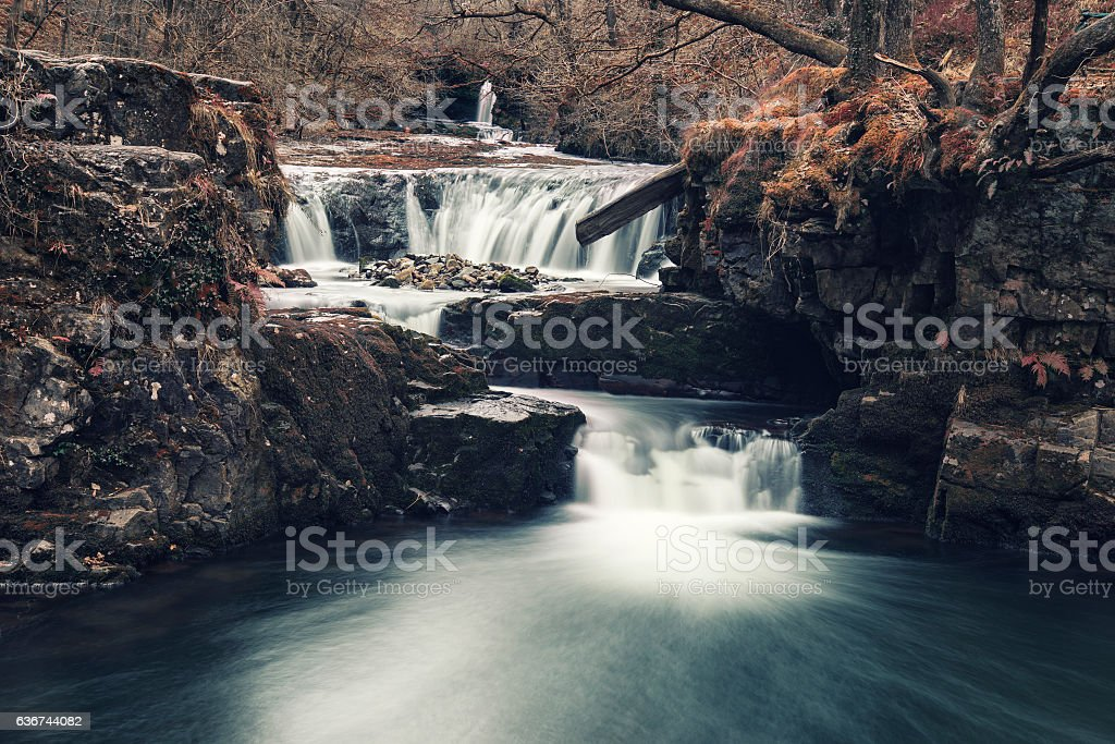 Beautiful waterfall landscape image in forest during Autumn Fall stock photo