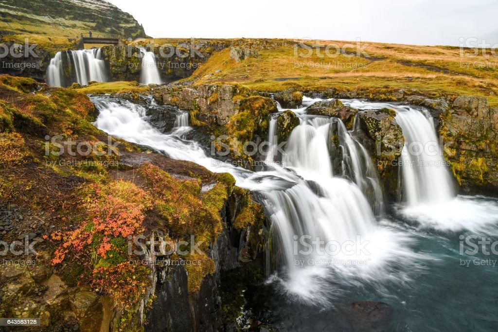 Beautiful waterfall near Kirkjufell mountain in Iceland stock photo