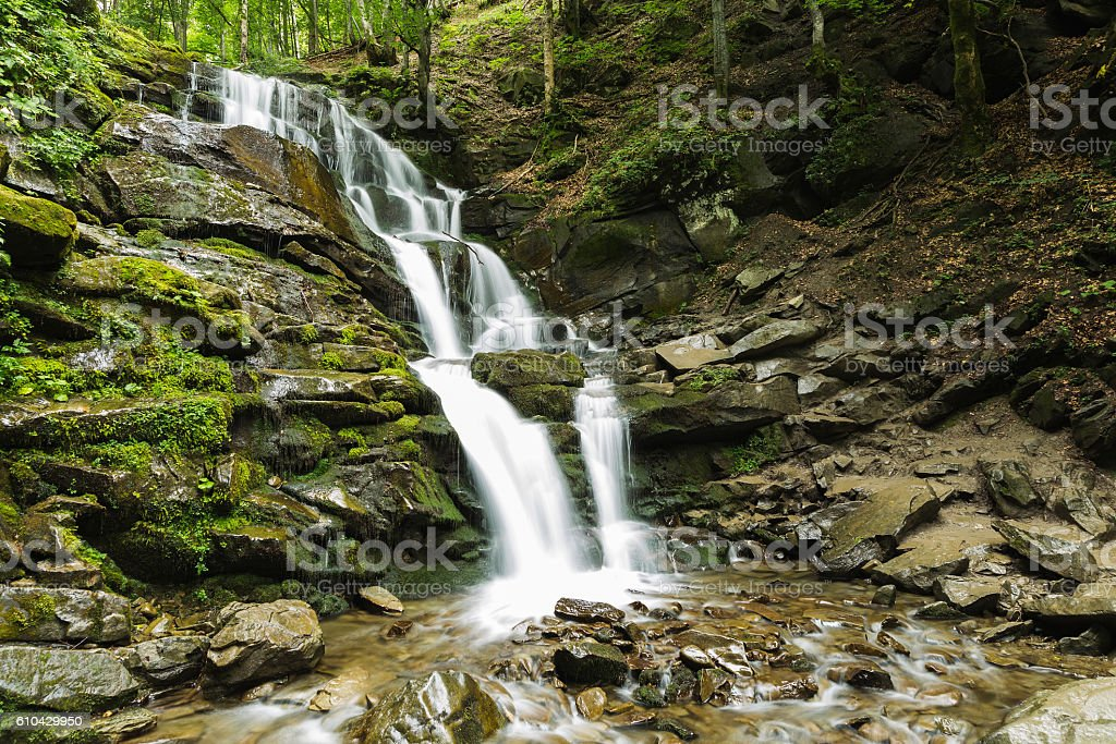 beautiful waterfall of mountain river stock photo