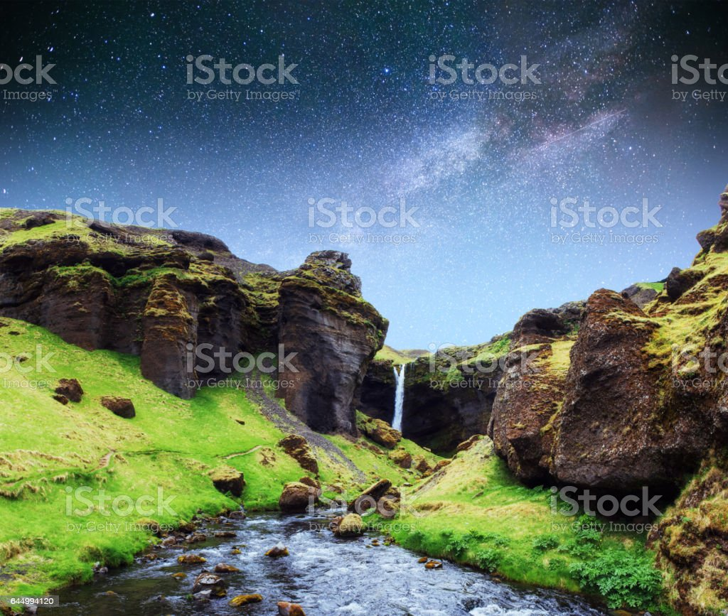 Beautiful waterfall. The starry sky and the Milky Way. Iceland. stock photo
