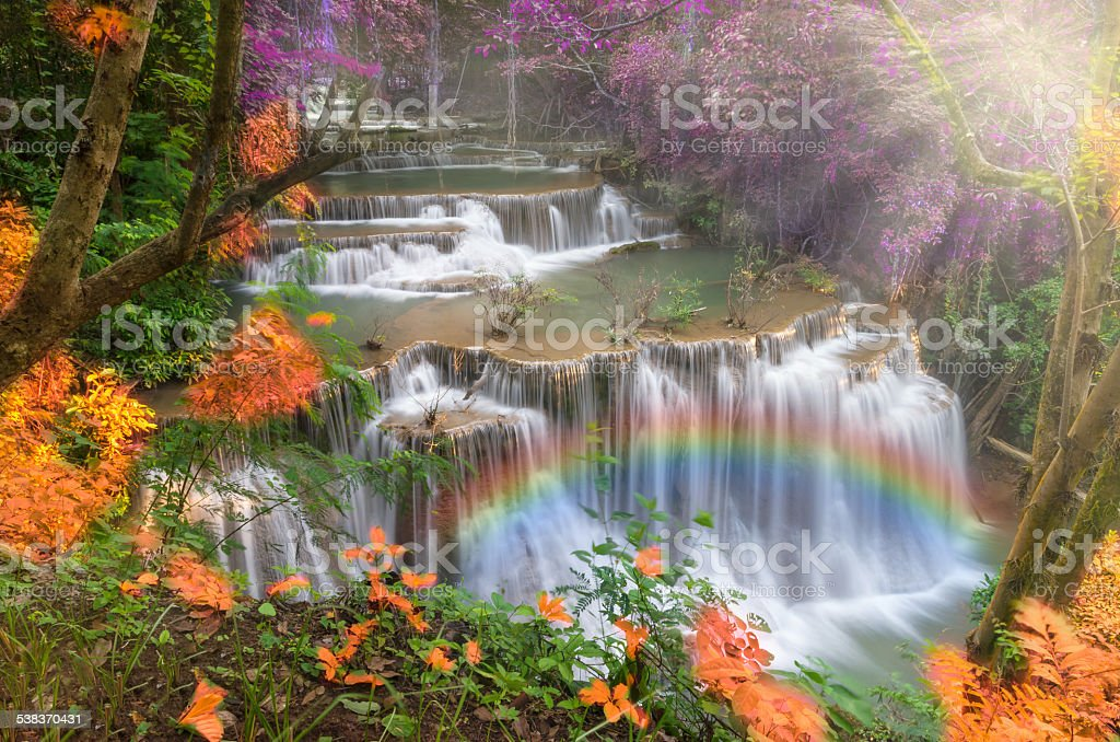 Beautiful waterfall with rainbow in the forest stock photo