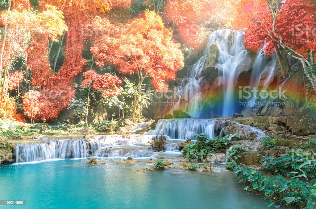 Beautiful waterfall with soft focus and rainbow in the forest stock photo