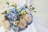 Beautiful wedding bouquet close up outdoor. Details, petals, leaves