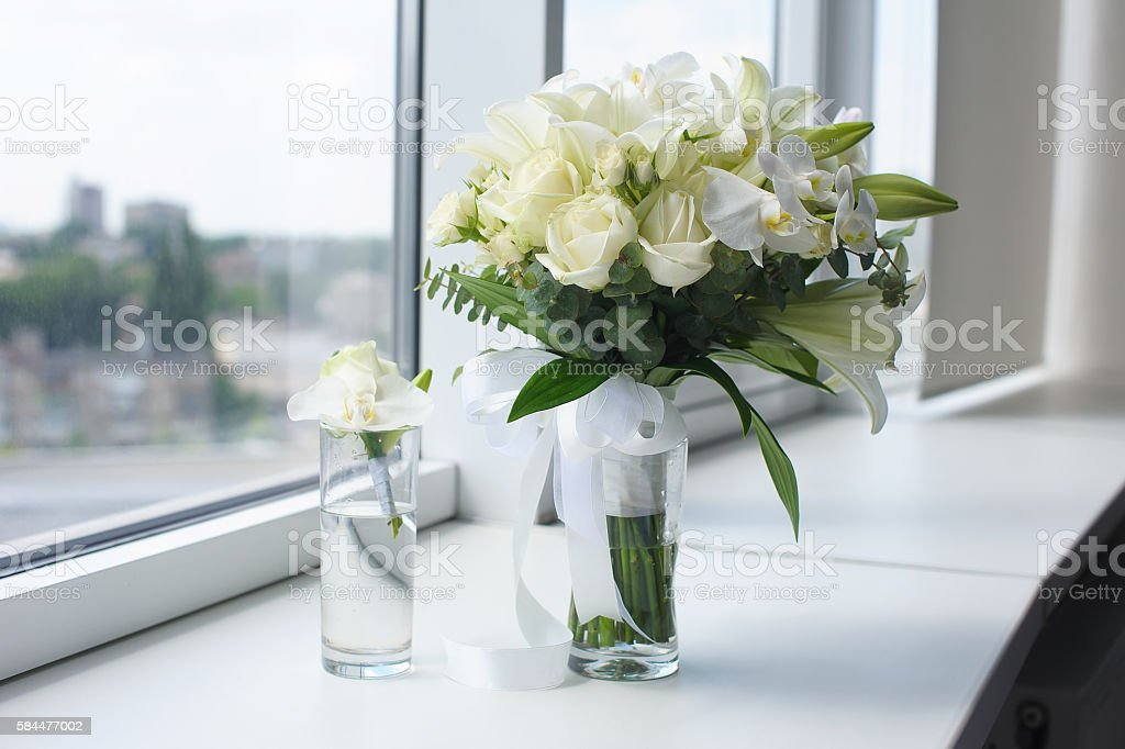 Beautiful wedding bouquet in a glass vase stock photo