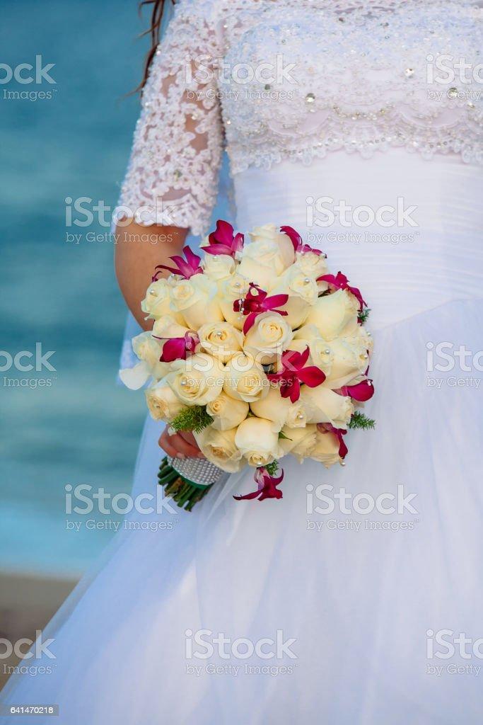 Beautiful wedding bouquet in bride's hand stock photo