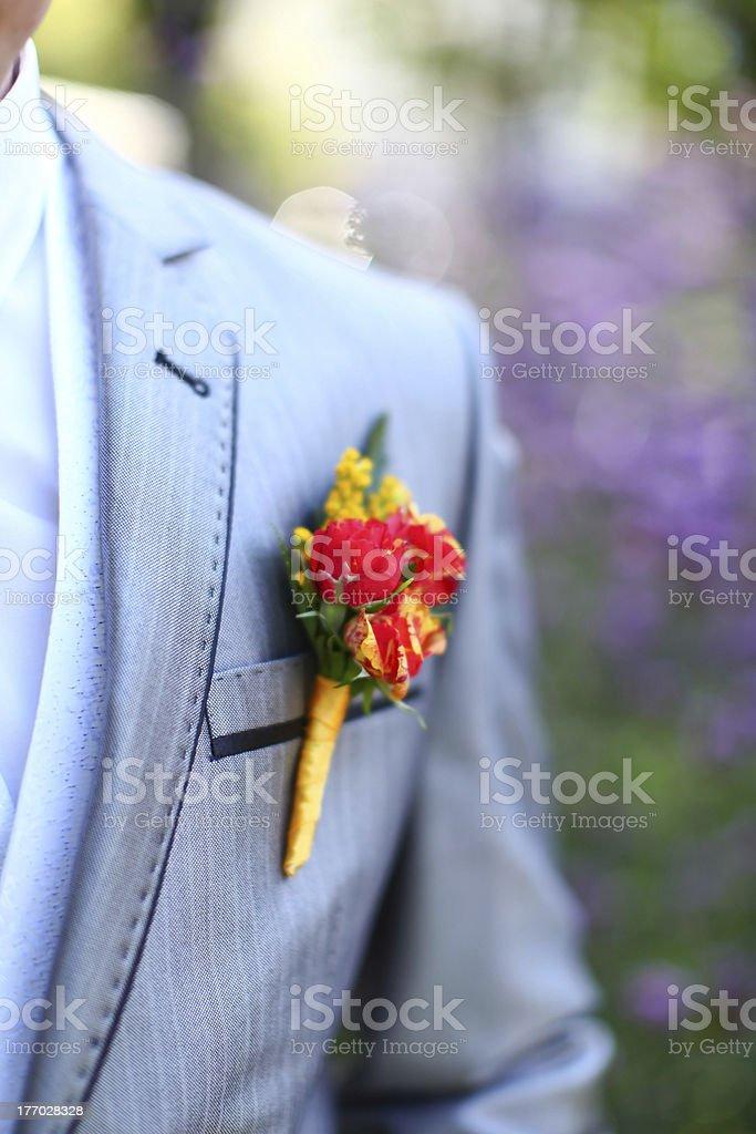 Beautiful wedding boutonniere at groom's costume stock photo