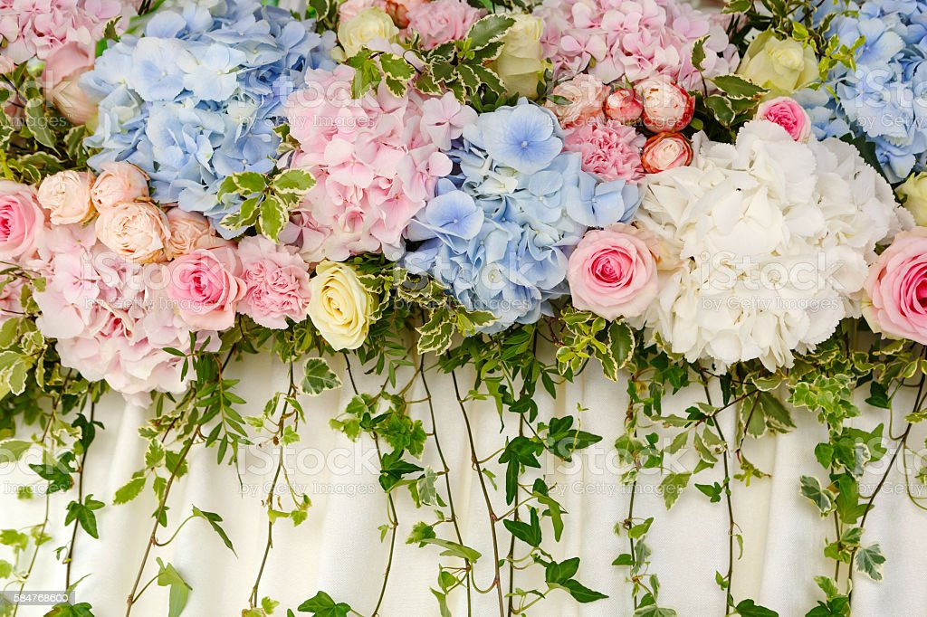 beautiful wedding decoration of pink and blue hydrangeas and ros stock photo