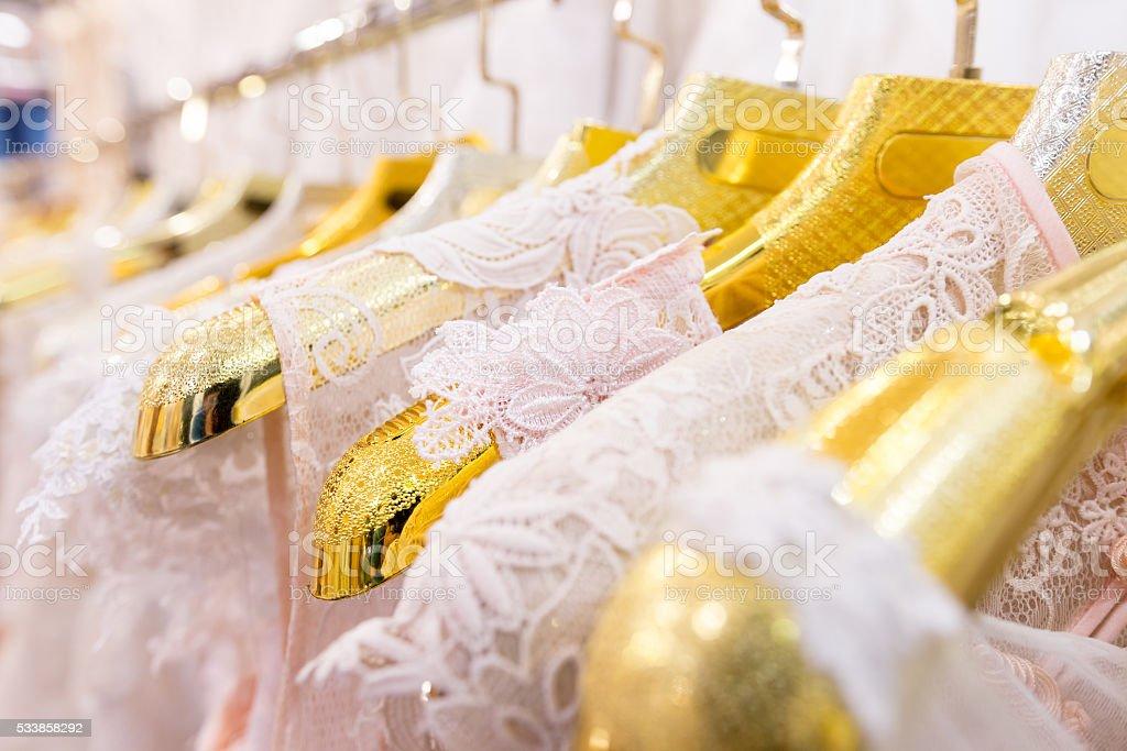 Beautiful wedding dresses on a hanger. stock photo