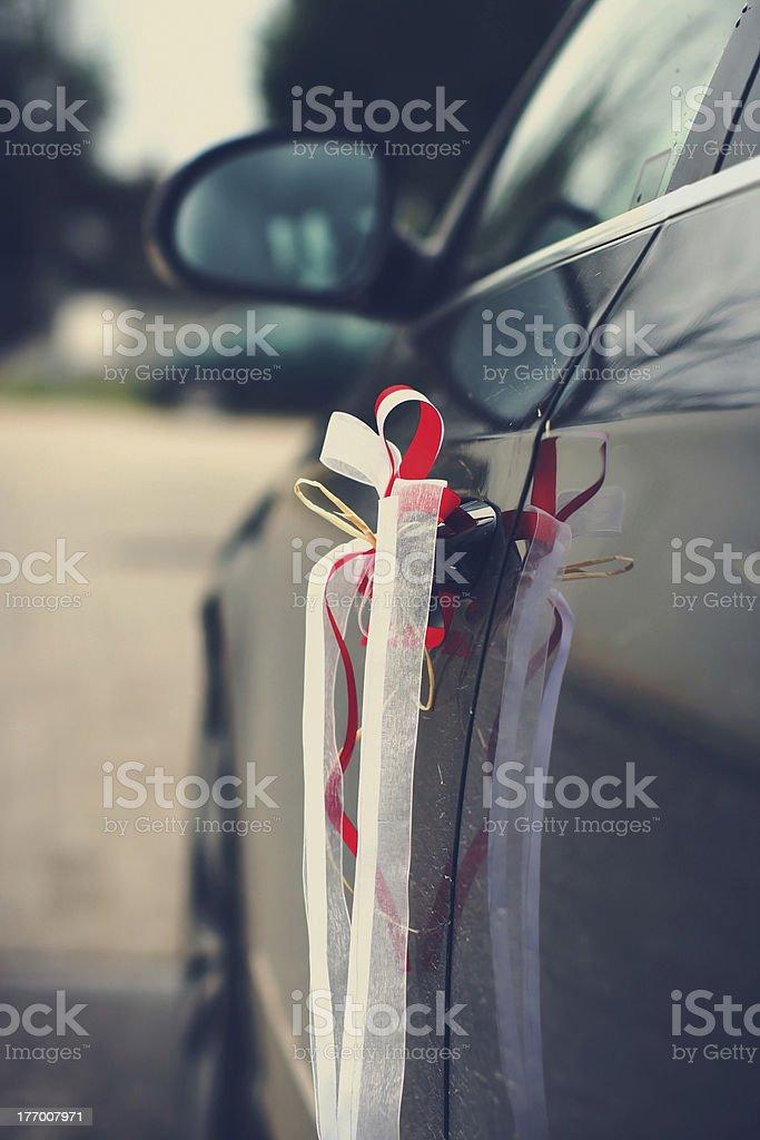 Beautiful wedding ribbons on a car stock photo
