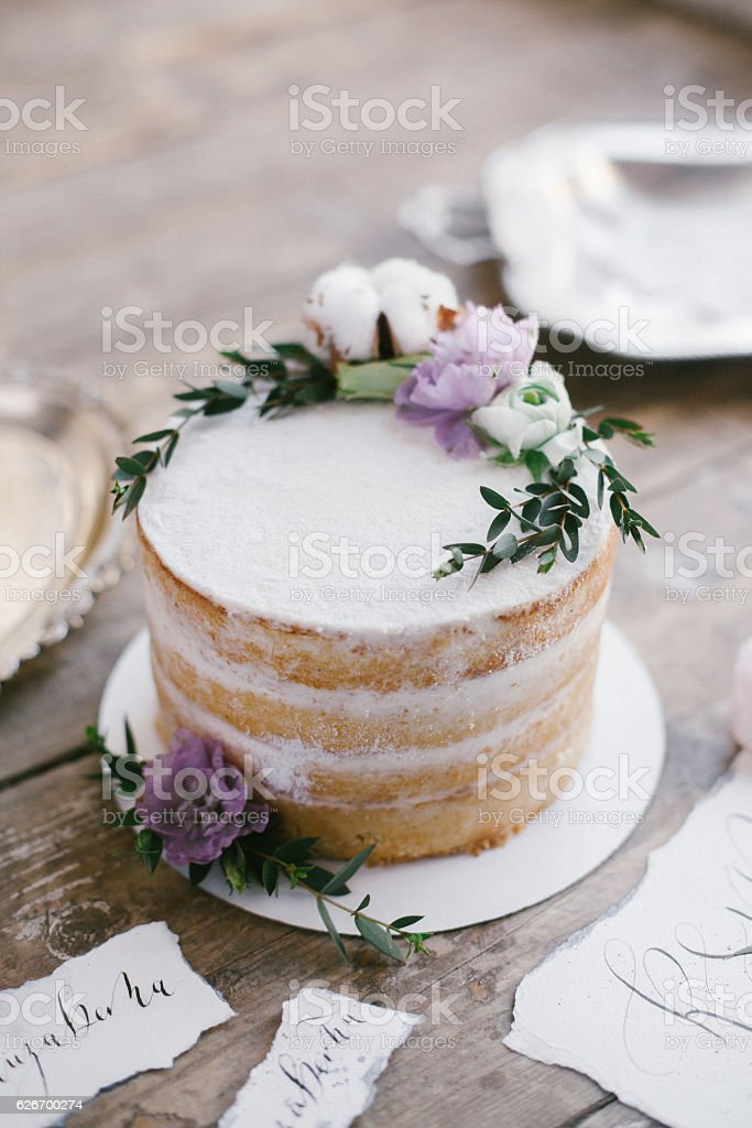 Beautiful wedding round cake with floral decorations. stock photo