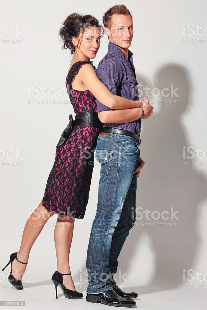 Beautiful Well Dressed  Couple posing on white background royalty-free stock photo