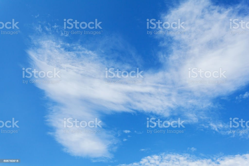 Beautiful white clouds over a deep blue background. stock photo