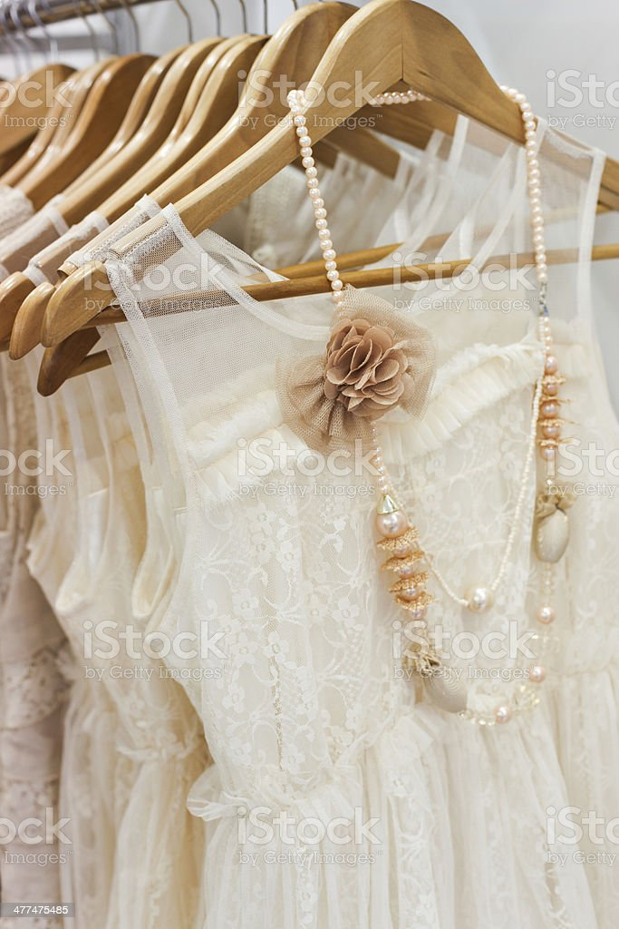 Beautiful white dresses in the store. stock photo