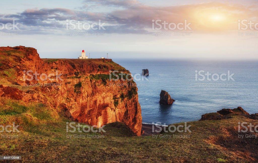 Beautiful white lighthouse at Cape Dyrholaey, South Iceland stock photo