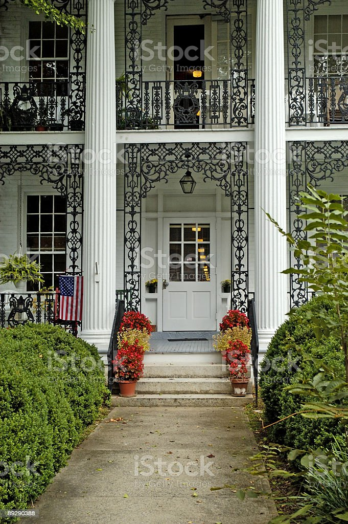 beautiful white mansion in old town with American Flag royalty-free stock photo