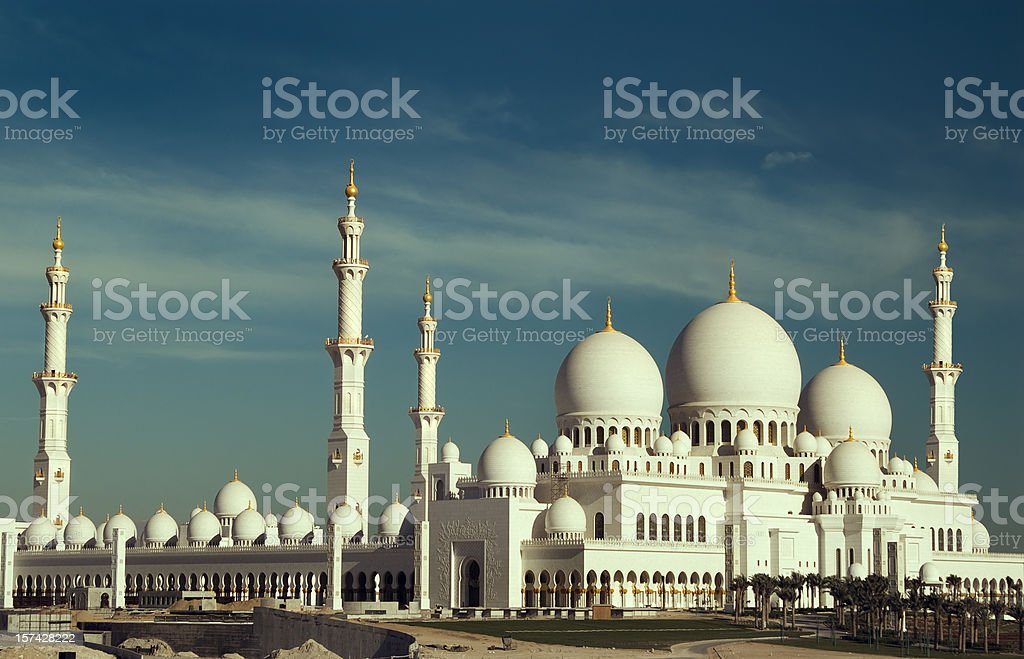 A beautiful white mosque on a partly cloudy day royalty-free stock photo