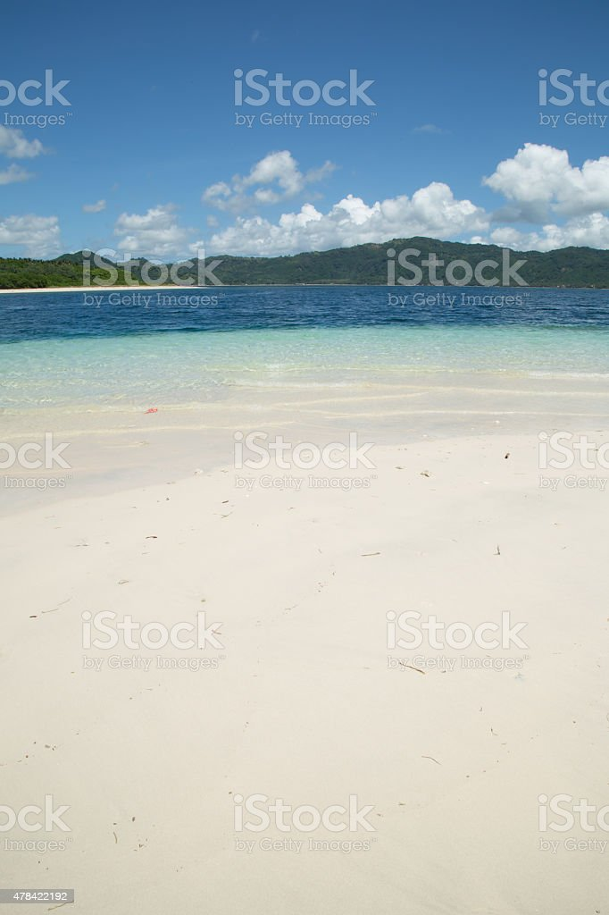 Beautiful white sand beach and blue sky white clouds stock photo