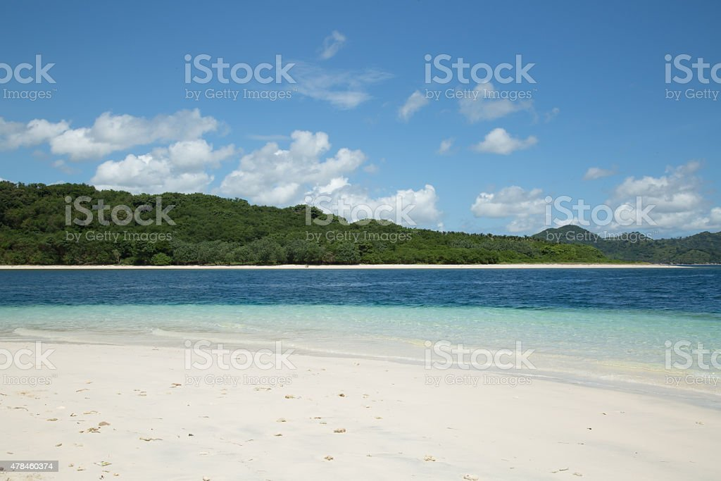 Beautiful white sand beach with clear sea water stock photo