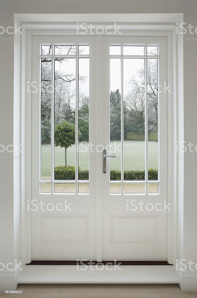 beautiful white wooden patio doors stock photo