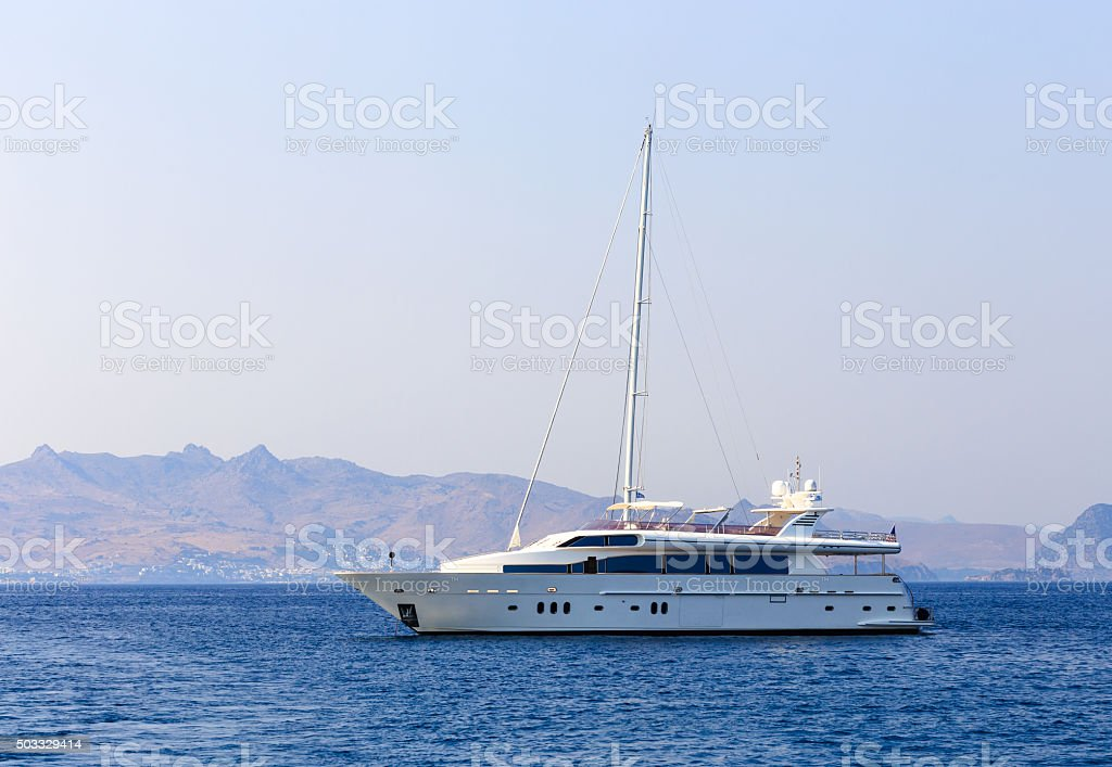 Beautiful white yacht on the sea stock photo
