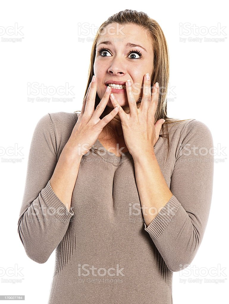 Beautiful, wide eyed, terrified young woman, hands to face stock photo