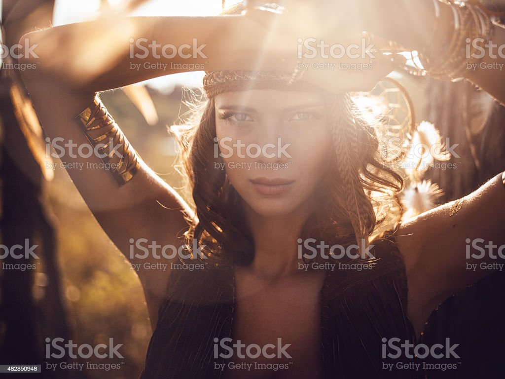 Beautiful wild girl portrait in golden sun flare stock photo