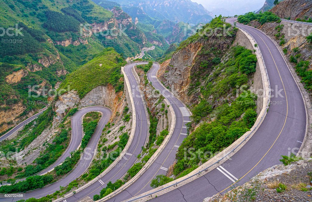 beautiful winding mountain road stock photo