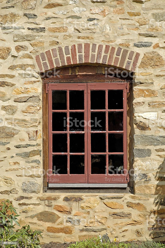 beautiful window in old stone building royalty-free stock photo