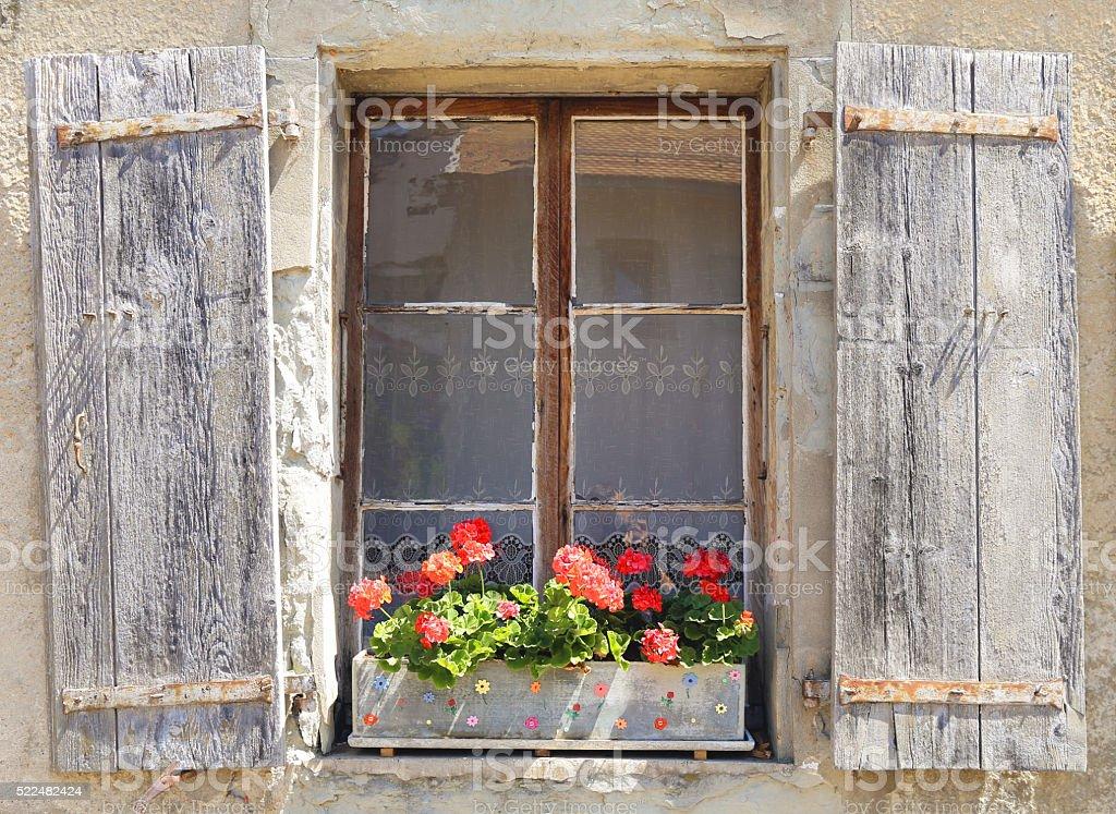 Beautiful window with flower box stock photo
