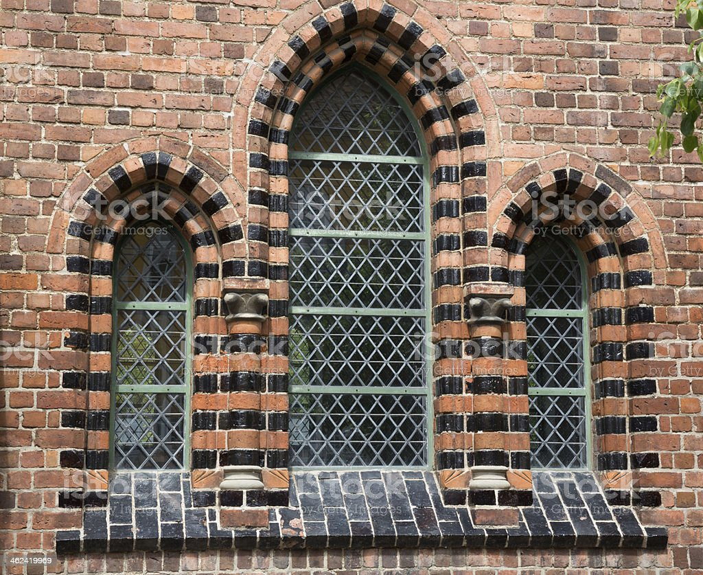 Beautiful windows in Roskilde cathedral office building stock photo