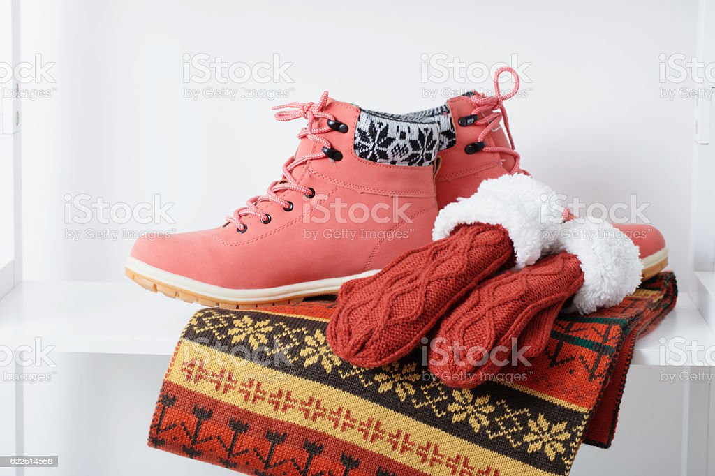 beautiful winter female clothes and shoes on white background stock photo