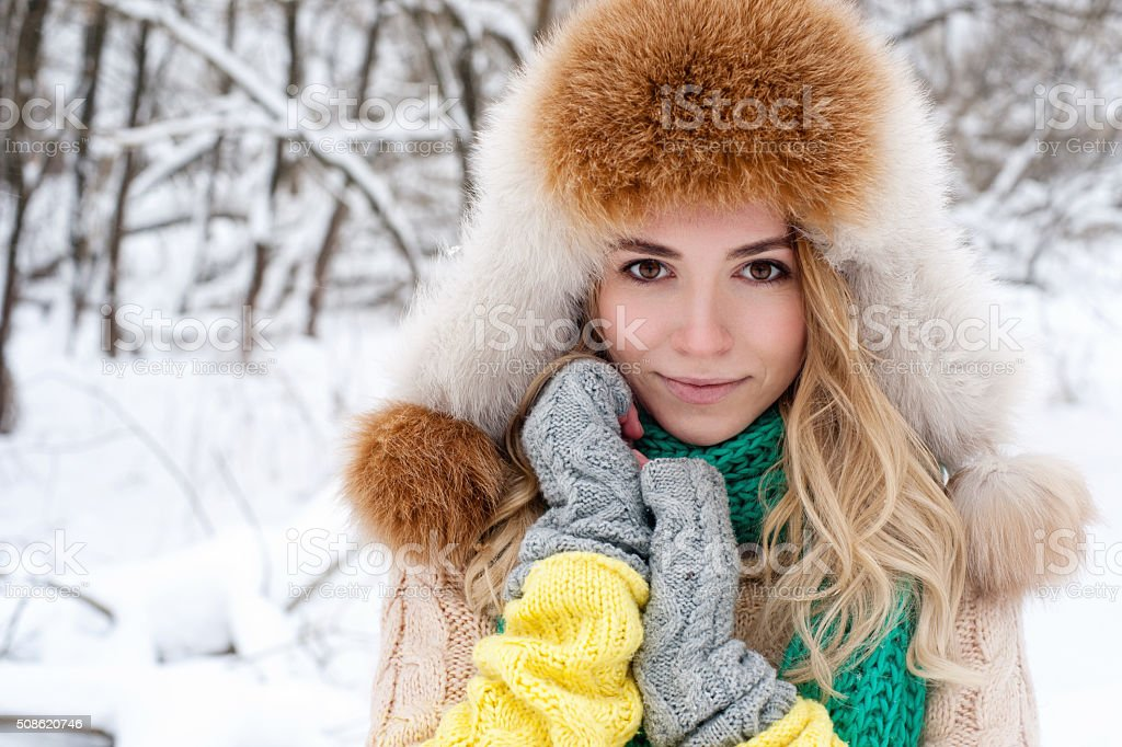 Beautiful winter portrait of young woman stock photo