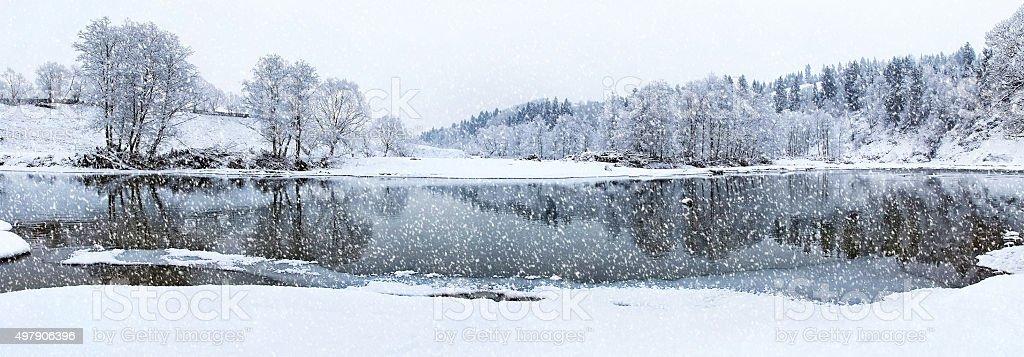 Beautiful winter river in snowfall stock photo
