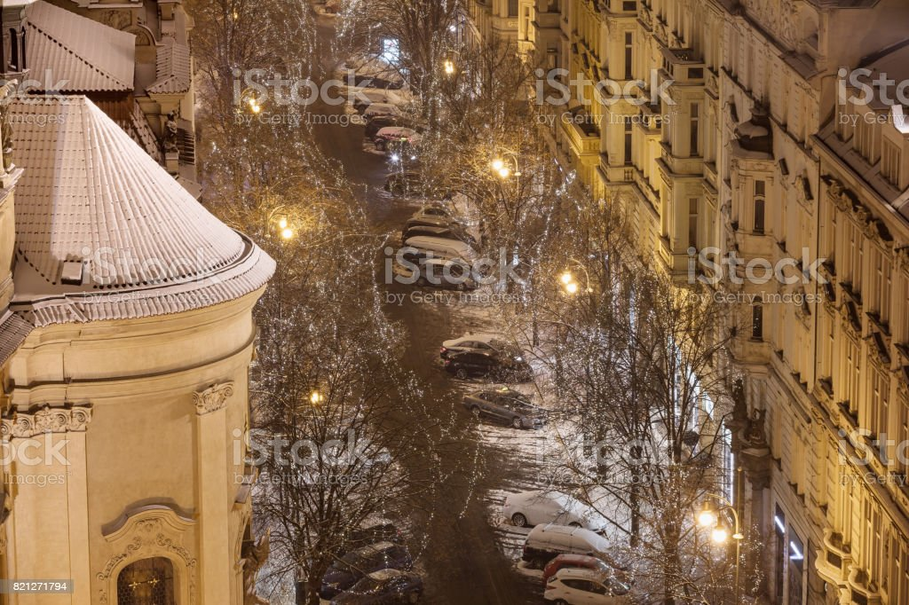 Beautiful winter snowy Prague. Looking to the lighted Parisian street. Prague's Old Town. Czech Republic stock photo