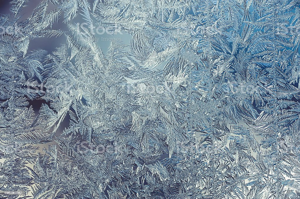 Beautiful Winter Window Pane Coated By Icy Frost Shiny Patterns stock photo