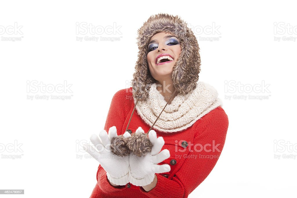 Beautiful winter woman playing with her fur hat. stock photo