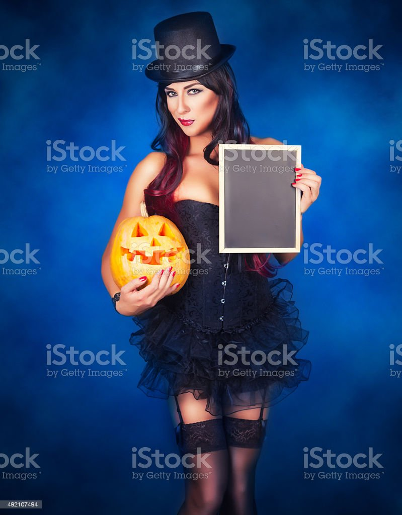 Beautiful witch in black gothic Halloween costume stock photo