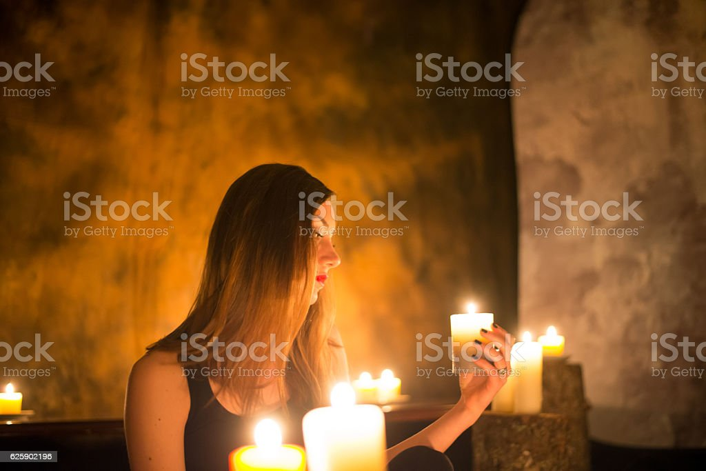 Beautiful witch making the witchcraft stock photo